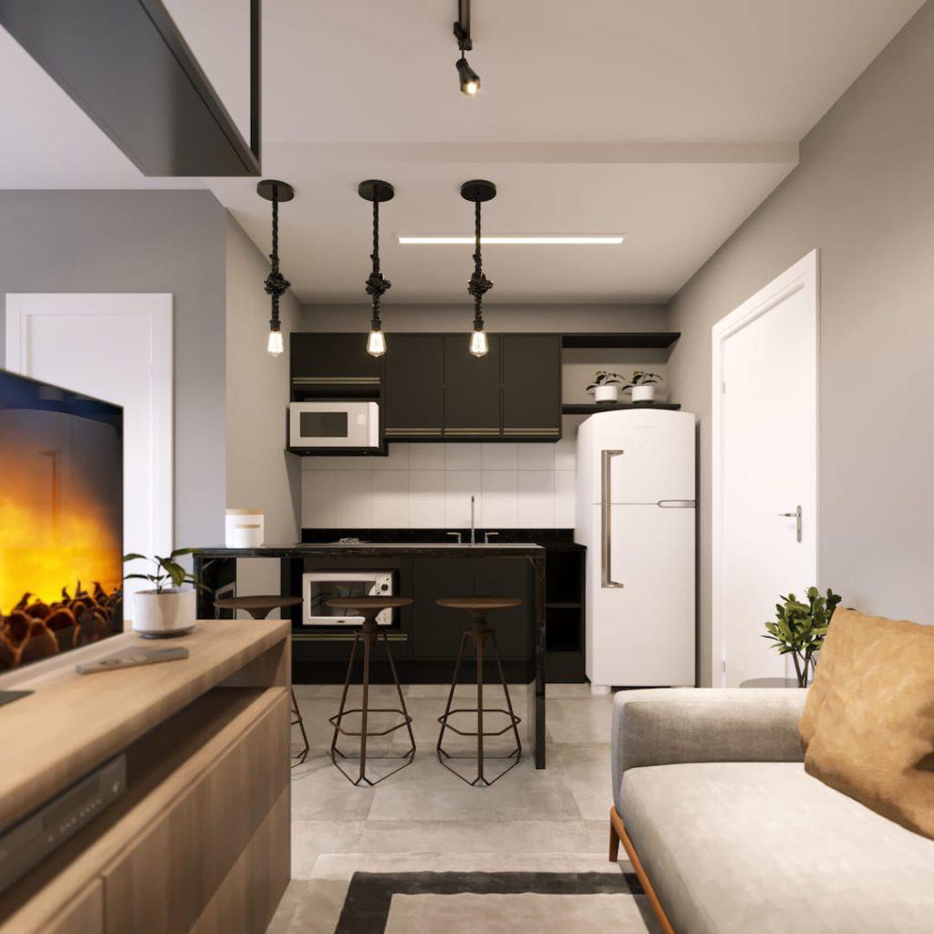 A imagem mostra o projeto da cozinha do apartamento, que seria feita com móveis sob medida. A cozinha é preta e os eletrodomésticos brancos. É possível ver também uma parte do sofá e da estante da sala.