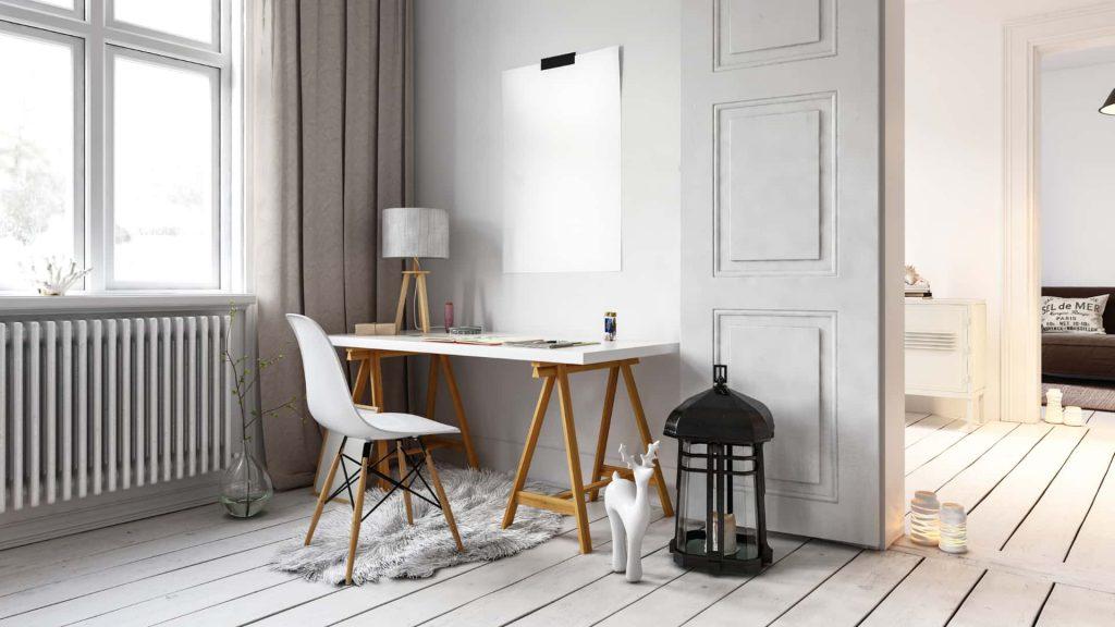 Cantinho de home office em decoração escandinava, usando escrivaninha branca com pés de madeira.