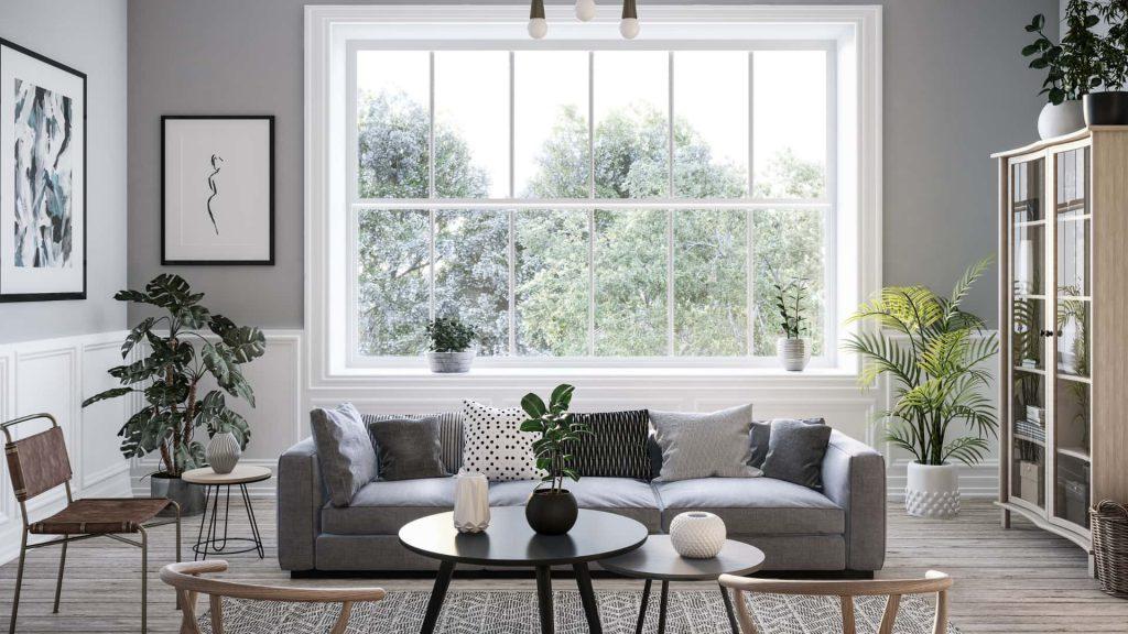 Outro exemplo de sala de estar decorada com o estilo escandinavo, dessa vez usando a cor cinza na decoração, como no sofá.